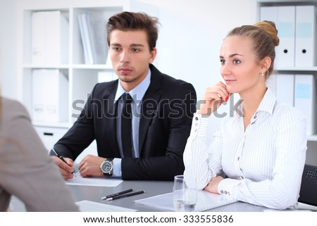 Cheerful business man in office with colleagues in the background, start  up team - Shutterstock ID 333555836