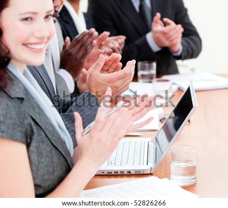 Cheerful business people applauding a good presentation in the office