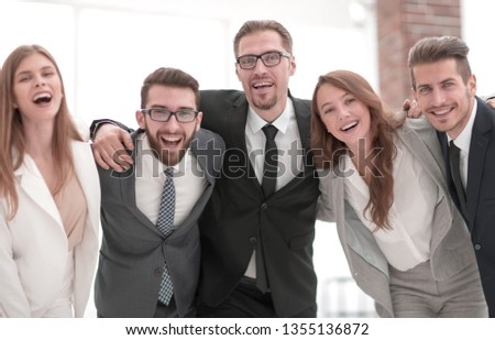 cheerful business team standing in the office #1355136872