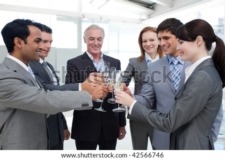 Cheerful business team toasting with Champagne to celebrate a success