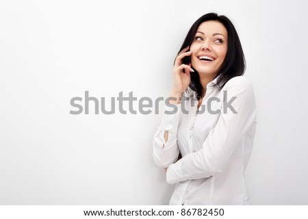 Cheerful business woman conversing on mobile phone