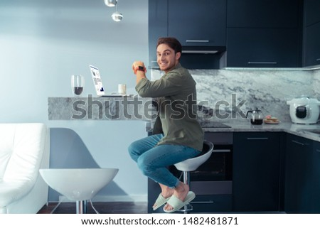 Cheerful businessman. Cheerful businessman smiling while spending morning in the kitchen #1482481871
