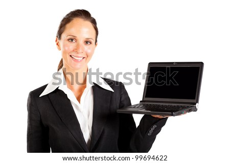 cheerful businesswoman presenting laptop computer on white
