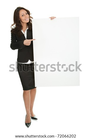 Cheerful businesswomen presenting empty board