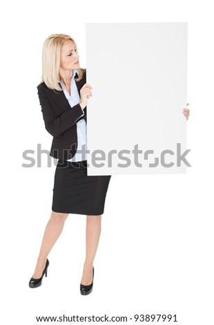 Cheerful businesswomen presenting empty board. Isolated on white