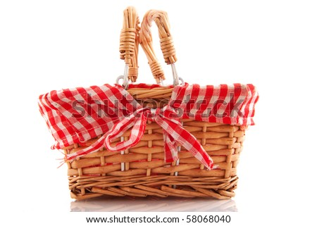 Cheerful cane basket for picnic or shopping - stock photo