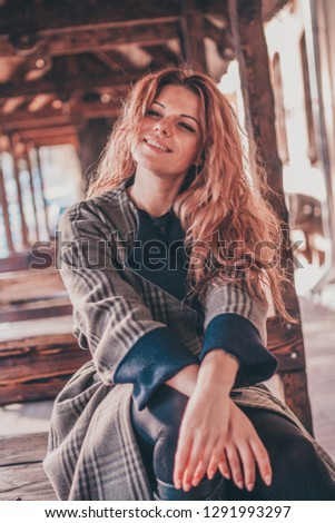 Cheerful cheerful attractive girl with luxurious hair and a charming smile #1291993297