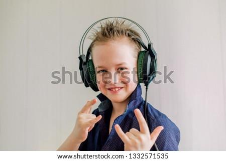 Cheerful cheerful boy with headphones #1332571535