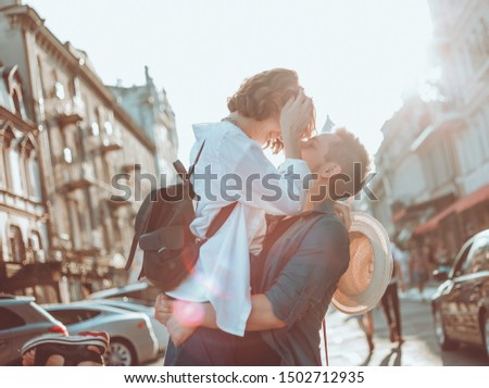Cheerful cheerful hipster couple in love kissing at city. The romantic concept of lovers. love story #1502712935