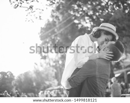 Cheerful cheerful hipster couple in love kissing in a city street. The romantic concept of lovers. love story #1499818121