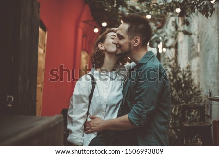 Cheerful cheerful hipster couple in love kissing in a city street. The romantic concept of lovers. love story #1506993809
