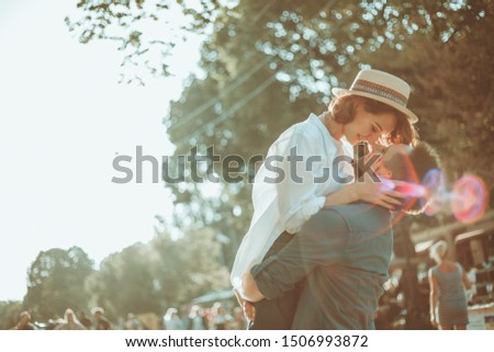 Cheerful cheerful hipster couple in love kissing in a city street. The romantic concept of lovers. love story #1506993872