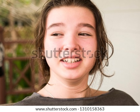 Cheerful cheerful teen girl outdoor portrait close-up #1310158363