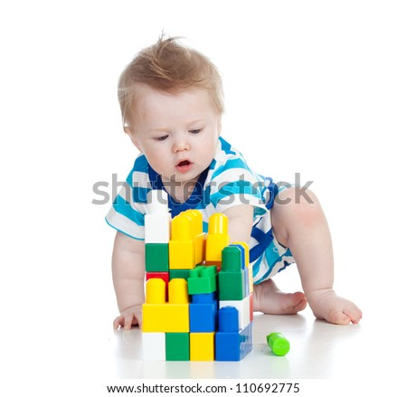 cheerful child boy with construction set over white background