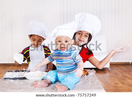 Cheerful children in aprons and hats