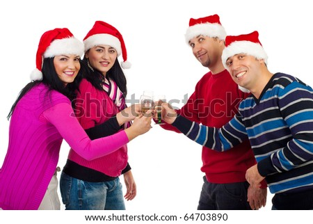 Cheerful Christmas friends with Santa hats toasting with champagne and smiling isolated on white background