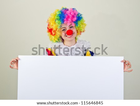 Cheerful clown holding a blank banner for placing of your text.