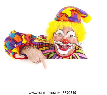 Cheerful clown pointing to blank white space.  Isolated design element.