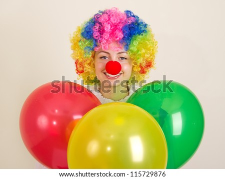 Cheerful clown with colorful balloons.
