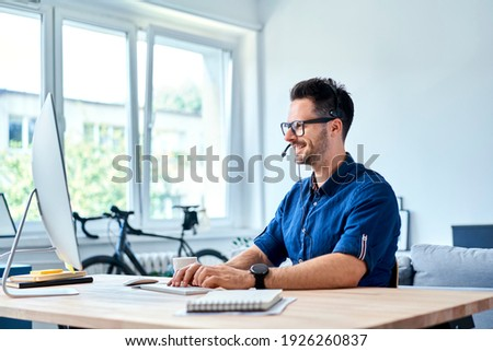 Cheerful consultant working at home