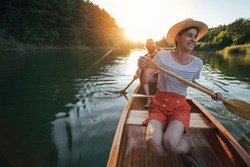 Cheerful couple enjoy summer boat ride on the lake, copy space