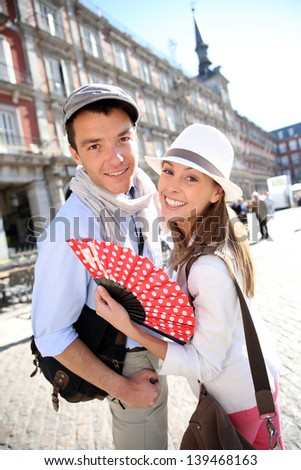 Cheerful couple enjoying tour in Madrid