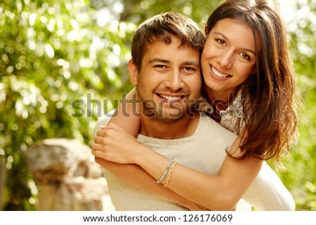 Cheerful couple having fun on summer vacation