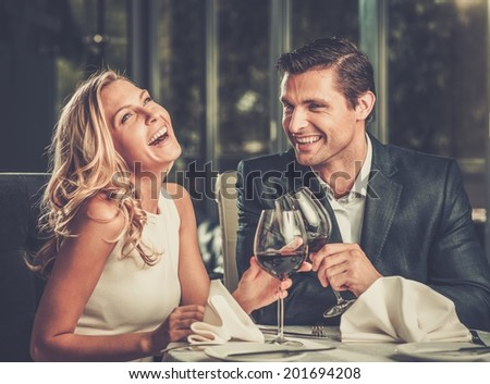 Cheerful couple in a restaurant with glasses of red wine #201694208