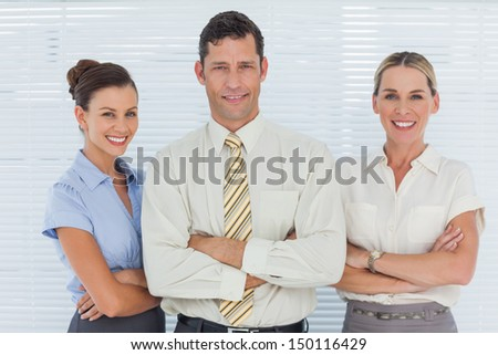 Cheerful coworkers posing together in bright office