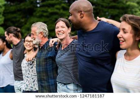 Cheerful diverse people together in the park #1247181187