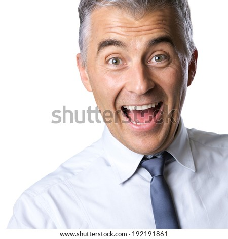 Cheerful excited businessman with mouth open and raised eyebrows on white background.