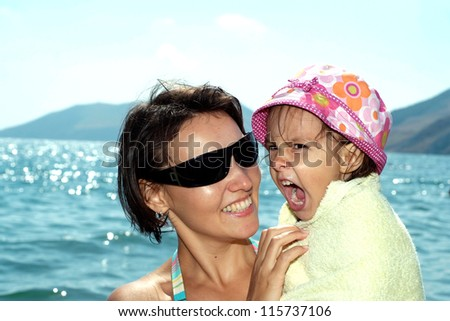 Cheerful family came to the beach to relax sea