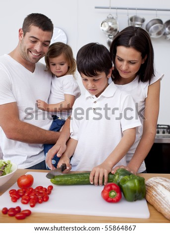 Cheerful family cooking together in the kitchen