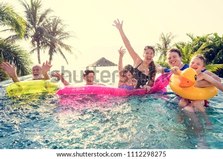 Cheerful family enjoying the summertime in a pool
