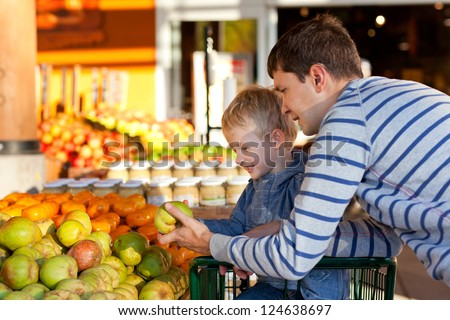 cheerful family of two at the farmers market