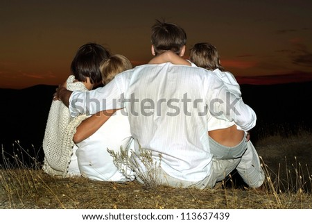 Cheerful family to watch the sunset together