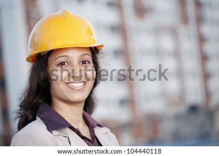 Cheerful female construction engineer