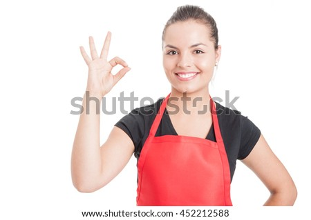 Cheerful female employee on supermarket doing ok sign as great sales concept isolated on white background #452212588