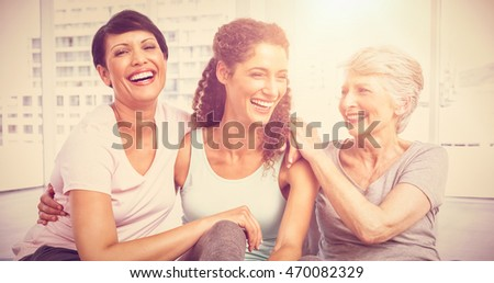 Cheerful fit women sitting in the yoga class #470082329