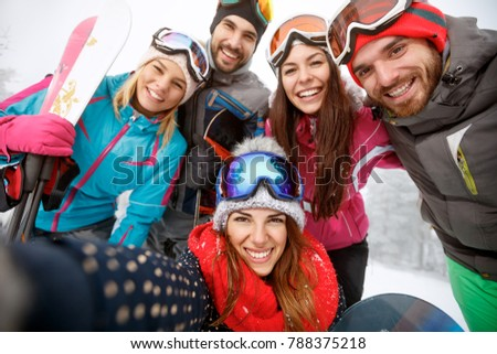 Cheerful friends together at skiing