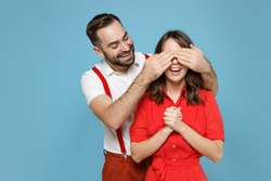 Cheerful funny young couple friends man woman in white red clothes close eyes with hands, play guess who or hide and seek isolated on blue background studio portrait. Valentine's Day holiday concept