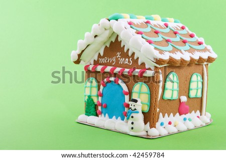 Cheerful gingerbread house on a green background