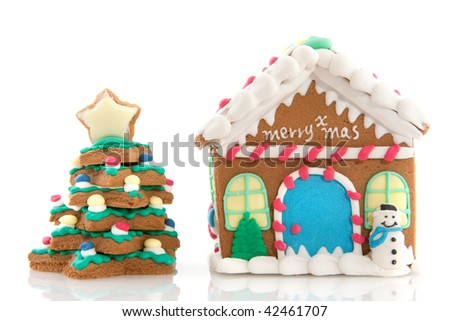 Cheerful gingerbread house on a pink background