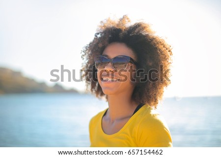 Cheerful girl at the beach, smiling a lot