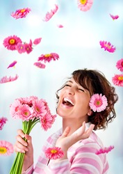 cheerful girl with a bouquet of pink flowers