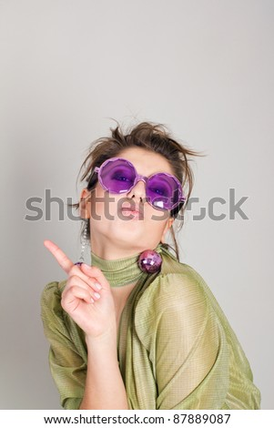 Cheerful girl with hat in hand in a festive mood. Clipping path