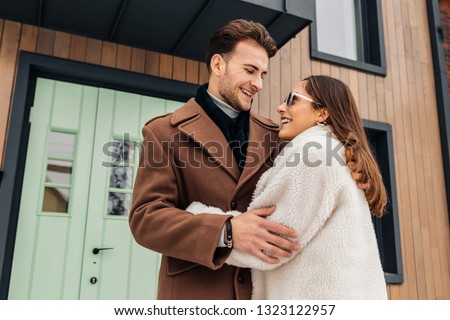 Cheerful girlfriend. Cheerful girlfriend feeling excited while moving in new house with her man #1323122957