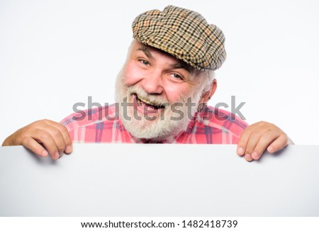 cheerful grandpa. job search. Need help. wanted. Copy space placate information. happy mature man in retro hat. Advertisement. Advertisement shop. Senior bearded man place announcement on banner.