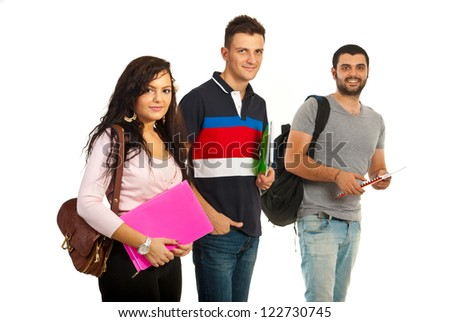 Cheerful group of three students isolated on white background