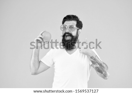 Cheerful guy with ripe fruit. Summer vacation. Fresh and healthy. Summer nutrition. Hipster with beard in summer mood. Juicy fruit. Man bearded hipster in orange sunglasses on yellow background. #1569537127